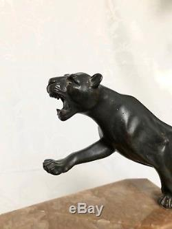 Archer et lionne grand bronze sur marbre Art Deco signé P. Hugonnet