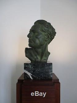 Sculpture Mermoz régule patiné bronze Art Déco et colonne éclairante De Viggo