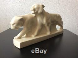 Sculpture animalière couple de panthères en céramique craquelée Art Déco