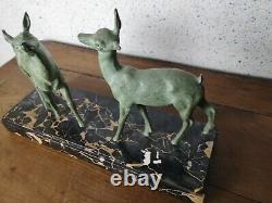 Sculpture de style art déco biches en métal patiné signée